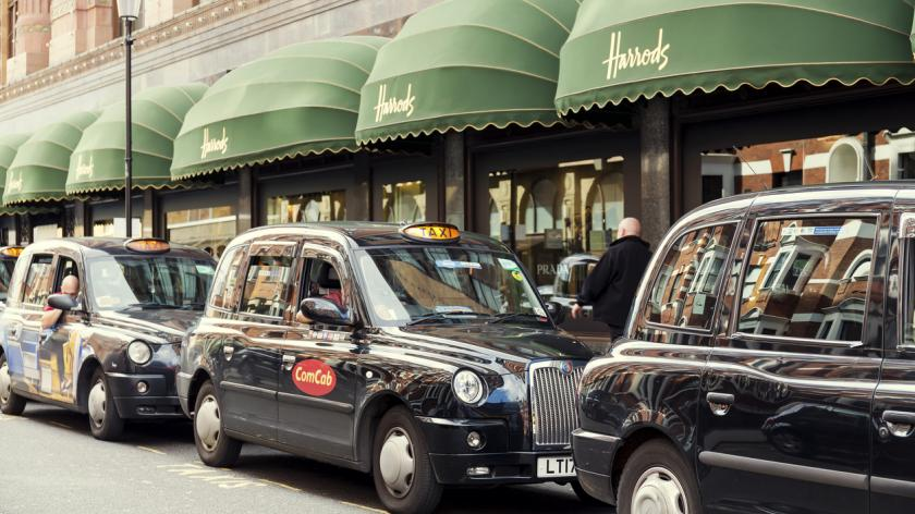 Taxis waiting in a queue outside Harrods in London