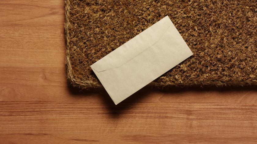Letter on doormat stock