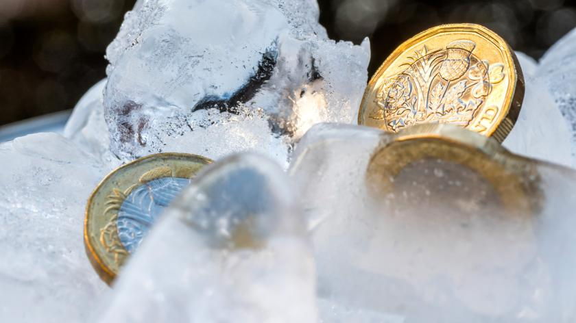 Frozen New British one pound sterling coin up close
