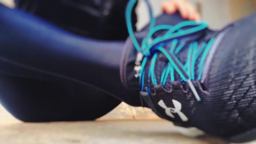 Person Wearing Black Under Armour Lace-up Shoe