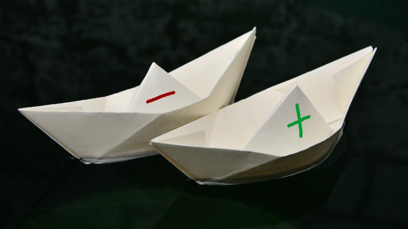 paper boats on the water