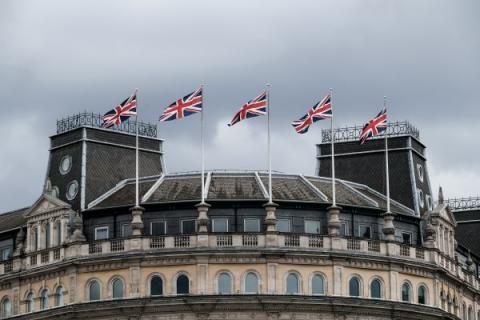 London buildings with Union Jack flags