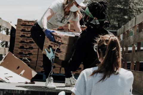 Charity workers unloading boxes from a truck