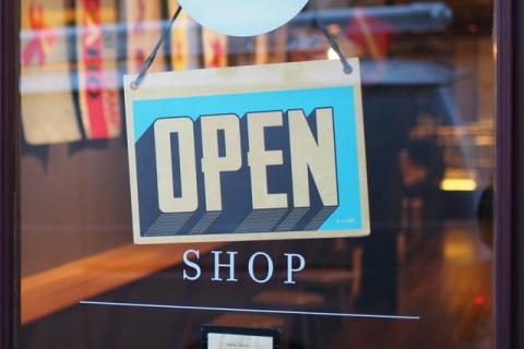 Shop window with 'we're open' sign