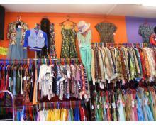 Original photo of Blue17 shop front  interior left side wall rails, hanging Women's vintage clothing